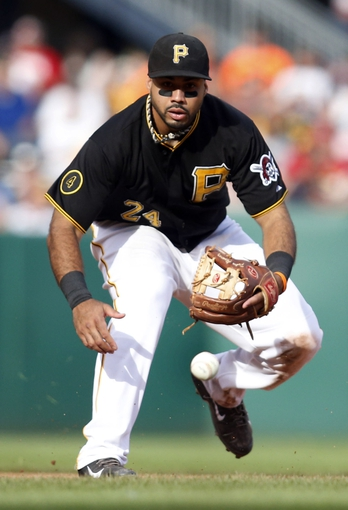 Jul 5, 2014; Pittsburgh, PA, USA; Pittsburgh Pirates third baseman Pedro Alvarez (24) fields a ground ball against the Philadelphia Phillies during the eighth inning at PNC Park. The Pirates won 3-2. Mandatory Credit: Charles LeClaire-USA TODAY Sports