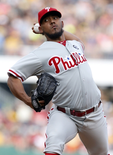 Jul 5, 2014; Pittsburgh, PA, USA; Philadelphia Phillies relief pitcher Antonio Bastardo (59) pitches against the Pittsburgh Pirates during the eighth inning at PNC Park. The Pirates won 3-2. Mandatory Credit: Charles LeClaire-USA TODAY Sports