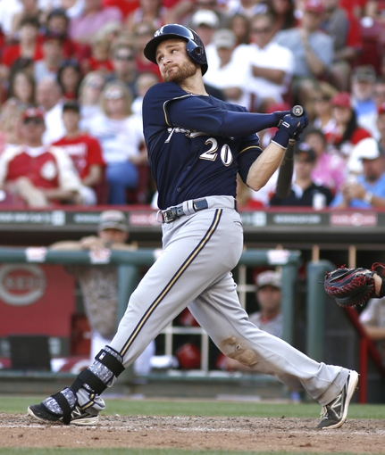 Jul 5, 2014; Cincinnati, OH, USA; Milwaukee Brewers catcher Jonathan Lucroy bats during a game against the Cincinnati Reds at Great American Ball Park. The Brewers won 1-0. Mandatory Credit: David Kohl-USA TODAY Sports