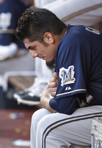 Jul 5, 2014; Cincinnati, OH, USA; Milwaukee Brewers starting pitcher Matt Garza sits in the dugout in the ninth inning during a game against the Cincinnati Reds at Great American Ball Park. The Brewers won 1-0. Mandatory Credit: David Kohl-USA TODAY Sports