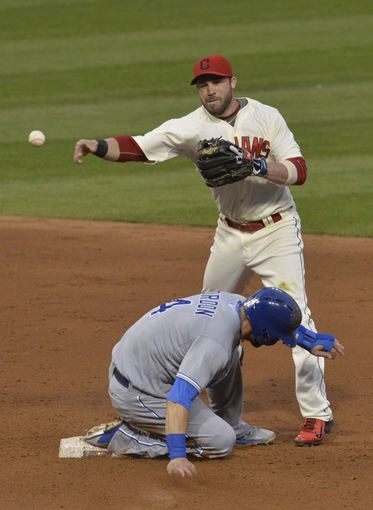 Jul 5, 2014; Cleveland, OH, USA; Cleveland Indians second baseman Jason Kipnis (22) throws to first base after forcing out Kansas City Royals left fielder Alex Gordon (4) on a fielder's choice in the sixth inning at Progressive Field. Mandatory Credit: David Richard-USA TODAY Sports