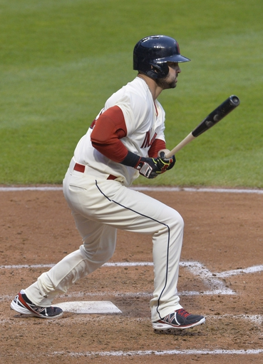 Jul 5, 2014; Cleveland, OH, USA; Cleveland Indians designated hitter Nick Swisher (33) hits a two-RBI single in the fifth inning against the Kansas City Royals at Progressive Field. Mandatory Credit: David Richard-USA TODAY Sports