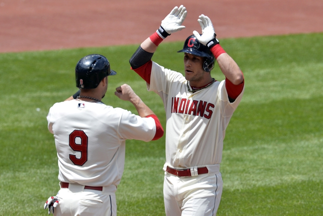 Jul 6, 2014; Cleveland, OH, USA; Cleveland Indians catcher Yan Gomes (right) celebrates his two-run home run with right fielder Ryan Raburn (9) in the second inning against the Kansas City Royals at Progressive Field. Mandatory Credit: David Richard-USA TODAY Sports