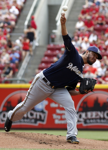 Jul 6, 2014; Cincinnati, OH, USA; Milwaukee Brewers starting pitcher Yovani Gallardo releases a pitch against the Cincinnati Reds during the first inning at Great American Ball Park. Mandatory Credit: David Kohl-USA TODAY Sports