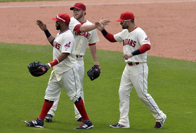 Jul 6, 2014; Cleveland, OH, USA; Cleveland Indians first baseman Carlos Santana (left), relief pitcher Cody Allen (center) and designated hitter Nick Swisher (33) celebrate a 4-1 win over the Kansas City Royals at Progressive Field. Mandatory Credit: David Richard-USA TODAY Sports