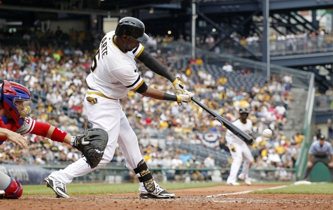 Jul 6, 2014; Pittsburgh, PA, USA; Pittsburgh Pirates left fielder Starling Marte (6) hits an RBI single against the Philadelphia Phillies during the eighth inning at PNC Park. The Pirates won 6-2. Mandatory Credit: Charles LeClaire-USA TODAY Sports