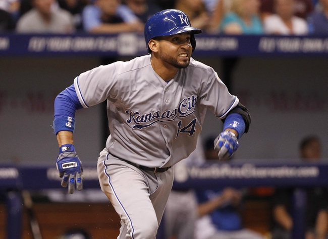 Jul 7, 2014; St. Petersburg, FL, USA; Kansas City Royals second baseman Omar Infante (14) doubles during the eighth inning against the Tampa Bay Rays at Tropicana Field. Mandatory Credit: Kim Klement-USA TODAY Sports