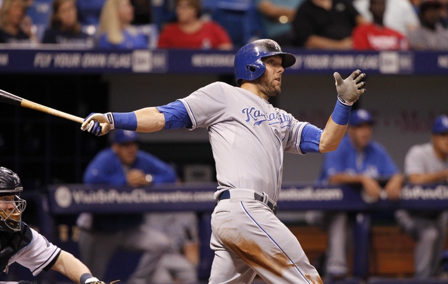 Jul 7, 2014; St. Petersburg, FL, USA; Kansas City Royals left fielder Alex Gordon (4) doubles during the eighth inning against the Tampa Bay Rays at Tropicana Field. Mandatory Credit: Kim Klement-USA TODAY Sports