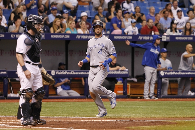 Jul 7, 2014; St. Petersburg, FL, USA; Kansas City Royals left fielder Alex Gordon (4) scores a run during the eighth inning against the Tampa Bay Rays at Tropicana Field. Mandatory Credit: Kim Klement-USA TODAY Sports