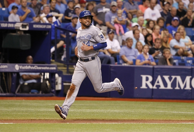 Jul 7, 2014; St. Petersburg, FL, USA; Kansas City Royals second baseman Omar Infante (14) runs home to score a run during the eighth inning against the Tampa Bay Rays at Tropicana Field. Mandatory Credit: Kim Klement-USA TODAY Sports