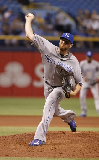 Jul 7, 2014; St. Petersburg, FL, USA; Kansas City Royals relief pitcher Wade Davis (17) throws a pitch during the eighth inning against the Tampa Bay Rays at Tropicana Field. Mandatory Credit: Kim Klement-USA TODAY Sports
