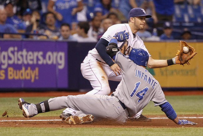 Jul 7, 2014; St. Petersburg, FL, USA; Kansas City Royals second baseman Omar Infante (14) slides into third base as Tampa Bay Rays third baseman Evan Longoria (3) attempts to tag him out during the eighth inning at Tropicana Field. Mandatory Credit: Kim Klement-USA TODAY Sports