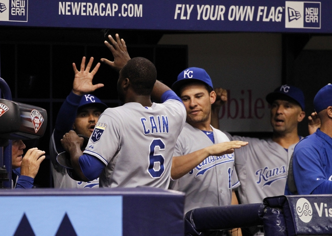 Jul 7, 2014; St. Petersburg, FL, USA; Kansas City Royals center fielder Lorenzo Cain (6) is congratulated by teammates after he scores during the ninth inning against the Tampa Bay Rays at Tropicana Field. Kansas City Royals defeated the Tampa Bay Rays 6-0.  Mandatory Credit: Kim Klement-USA TODAY Sports