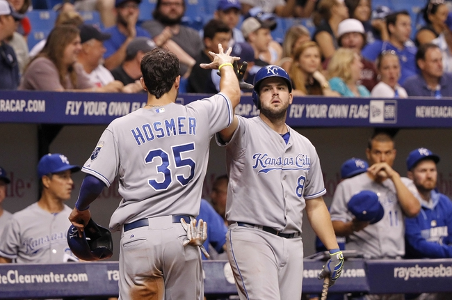 Jul 7, 2014; St. Petersburg, FL, USA; Kansas City Royals first baseman Eric Hosmer (35) is congratulated by third baseman Mike Moustakas (8) after he scores during the ninth inning against the Tampa Bay Rays at Tropicana Field. Kansas City Royals defeated the Tampa Bay Rays 6-0.  Mandatory Credit: Kim Klement-USA TODAY Sports