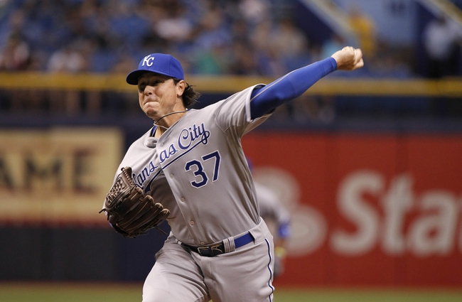 Jul 7, 2014; St. Petersburg, FL, USA; Kansas City Royals relief pitcher Scott Downs (37) throws a pitch during the ninth inning against the Tampa Bay Rays at Tropicana Field. Kansas City Royals defeated the Tampa Bay Rays 6-0.  Mandatory Credit: Kim Klement-USA TODAY Sports