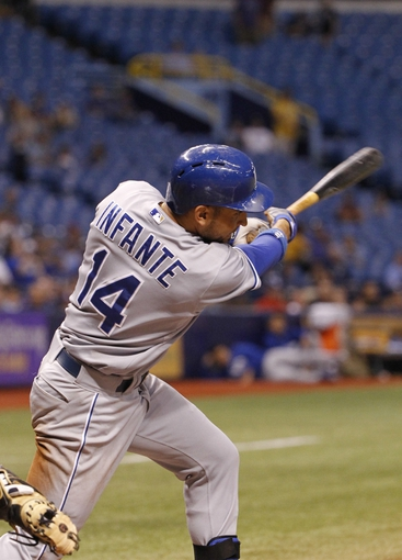 Jul 7, 2014; St. Petersburg, FL, USA; Kansas City Royals second baseman Omar Infante (14) singles during the ninth inning against the Tampa Bay Rays at Tropicana Field. Kansas City Royals defeated the Tampa Bay Rays 6-0.  Mandatory Credit: Kim Klement-USA TODAY Sports