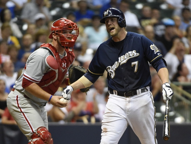 Jul 7, 2014; Milwaukee, WI, USA;   Milwaukee Brewers first baseman Mark Reynolds (7) reacts after striking out in the seventh inning during the game against the Philadelphia Phillies at Miller Park. The Phillies beat the Brewers 3-2. Mandatory Credit: Benny Sieu-USA TODAY Sports