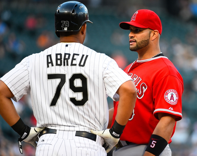 Jul 1, 2014; Chicago, IL, USA; Chicago White Sox first baseman Jose Abreu (79) and Los Angeles Angels first baseman Albert Pujols (5) during the ninth inning at U.S Cellular Field. Mandatory Credit: Mike DiNovo-USA TODAY Sports