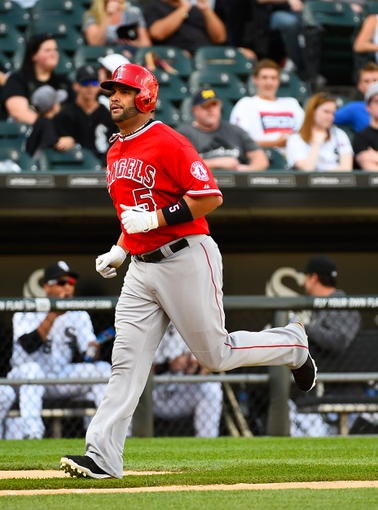 Jul 1, 2014; Chicago, IL, USA; Los Angeles Angels first baseman Albert Pujols (5) during the fifth inning at U.S Cellular Field. Mandatory Credit: Mike DiNovo-USA TODAY Sports