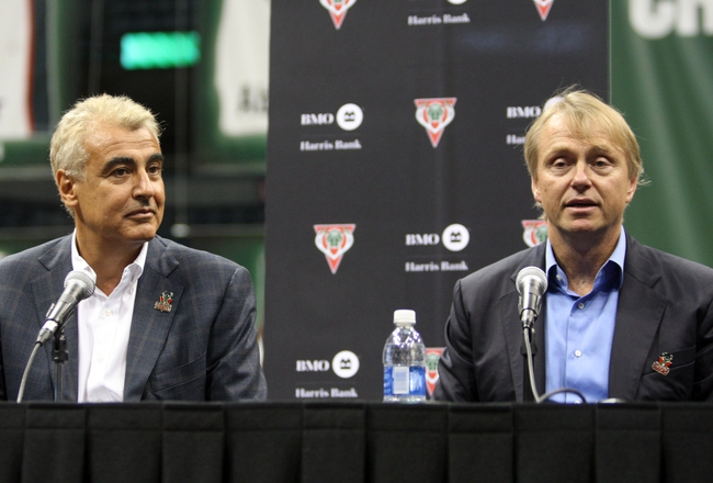 Jul 2, 2014; Milwaukee, WI, USA; Milwaukee Bucks co-owner Wesley Edens (right) speaks to the press as partner Marc Lasry listens during a news conference featuring new head coach Jason Kidd at the BMO Harris Bradley Center. Mandatory Credit: Mary Langenfeld-USA TODAY Sports