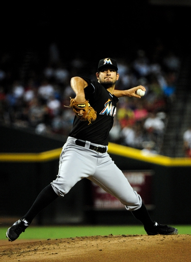 Jul 8, 2014; Phoenix, AZ, USA; Miami Marlins relief pitcher Brad Hand (52) throws during the first inning against the Arizona Diamondbacks at Chase Field. Mandatory Credit: Matt Kartozian-USA TODAY Sports