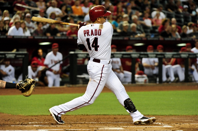 Jul 8, 2014; Phoenix, AZ, USA; Arizona Diamondbacks third baseman Martin Prado (14) hits a double during the second inning against the Miami Marlins at Chase Field. Mandatory Credit: Matt Kartozian-USA TODAY Sports