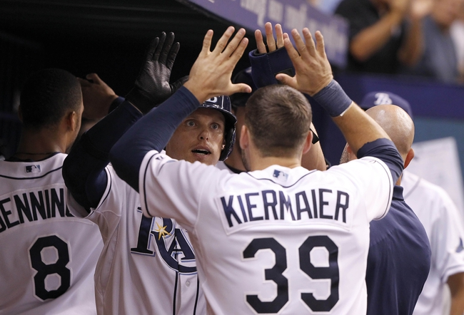 Jul 8, 2014; St. Petersburg, FL, USA; Tampa Bay Rays left fielder Brandon Guyer (5) is congratulated by right fielder Kevin Kiermaier (39) after he scored against the Kansas City Royals during the sixth inning at Tropicana Field. Mandatory Credit: Kim Klement-USA TODAY Sports