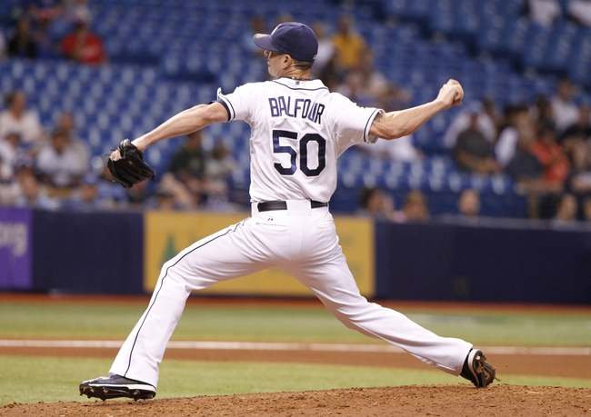 Jul 8, 2014; St. Petersburg, FL, USA; Tampa Bay Rays relief pitcher Grant Balfour (50) throws a pitch during the seventh inning against the Kansas City Royals at Tropicana Field. Mandatory Credit: Kim Klement-USA TODAY Sports