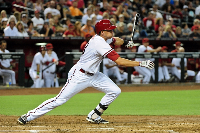 Jul 8, 2014; Phoenix, AZ, USA; Arizona Diamondbacks shortstop Nick Ahmed (13) hits a single during the second inning against the Miami Marlins at Chase Field. Mandatory Credit: Matt Kartozian-USA TODAY Sports