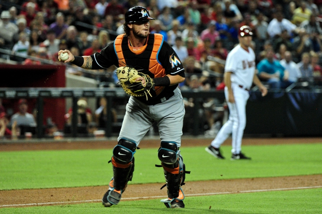 Jul 8, 2014; Phoenix, AZ, USA; Miami Marlins catcher Jarrod Saltalamacchia (39) fields the ball during the second inning against the Arizona Diamondbacks at Chase Field. Mandatory Credit: Matt Kartozian-USA TODAY Sports