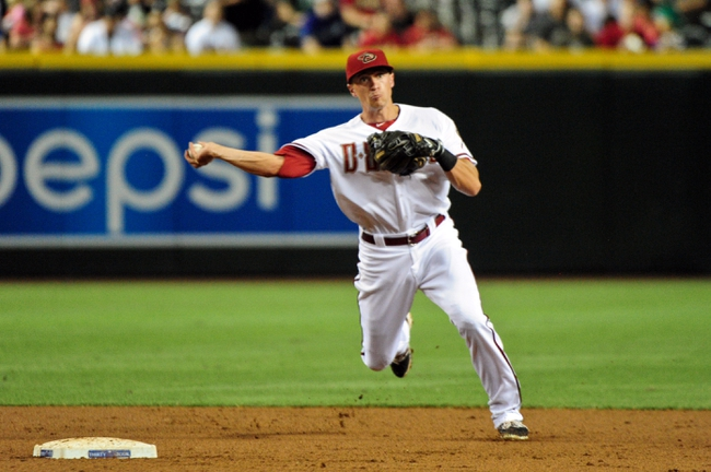 Jul 8, 2014; Phoenix, AZ, USA; Arizona Diamondbacks shortstop Nick Ahmed (13) throws to first base during the third inning against the Miami Marlins at Chase Field. Mandatory Credit: Matt Kartozian-USA TODAY Sports
