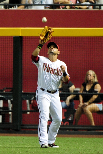 Jul 8, 2014; Phoenix, AZ, USA; Arizona Diamondbacks right fielder Gerardo Parra (8) catches a ball hit by Miami Marlins catcher Jarrod Saltalamacchia (not pictured) during the fifth inning at Chase Field. Mandatory Credit: Matt Kartozian-USA TODAY Sports