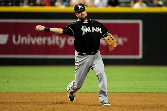 Jul 8, 2014; Phoenix, AZ, USA; Miami Marlins third baseman Casey McGehee (9) throws to first base during the fourth inning against the Arizona Diamondbacks at Chase Field. Mandatory Credit: Matt Kartozian-USA TODAY Sports