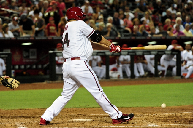 Jul 8, 2014; Phoenix, AZ, USA; Arizona Diamondbacks starting pitcher Vidal Nuno (54) hits a single during the fifth inning against the Miami Marlins at Chase Field. Mandatory Credit: Matt Kartozian-USA TODAY Sports