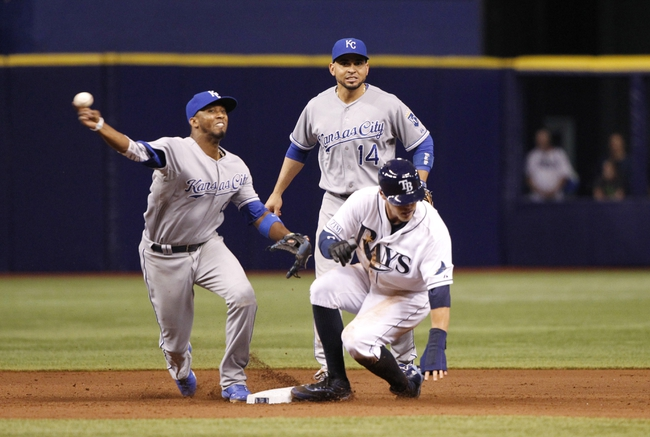 Jul 8, 2014; St. Petersburg, FL, USA; Tampa Bay Rays left fielder Brandon Guyer (5) slides safe into second base as Kansas City Royals shortstop Alcides Escobar (2) attempted to tag him out and then attemoted to throw to first but was also safe during the eighth inning at Tropicana Field. Tampa Bay Rays defeated the Kansas City Royals 4-3. Mandatory Credit: Kim Klement-USA TODAY Sports