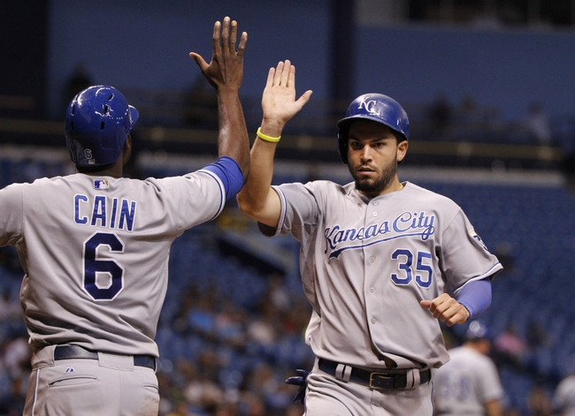 Jul 8, 2014; St. Petersburg, FL, USA; Kansas City Royals first baseman Eric Hosmer (35) and center fielder Lorenzo Cain (6) congratulate each other after they scored during the ninth inning against the Tampa Bay Rays at Tropicana Field. Tampa Bay Rays defeated the Kansas City Royals 4-3. Mandatory Credit: Kim Klement-USA TODAY Sports