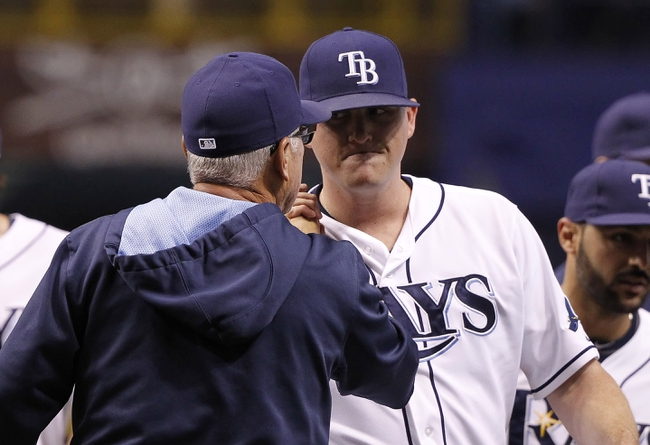 Jul 8, 2014; St. Petersburg, FL, USA; Tampa Bay Rays manager Joe Maddon (70) congratulate relief pitcher Jake McGee (57) after they beat the Kansas City Royals at Tropicana Field. Tampa Bay Rays defeated the Kansas City Royals 4-3. Mandatory Credit: Kim Klement-USA TODAY Sports