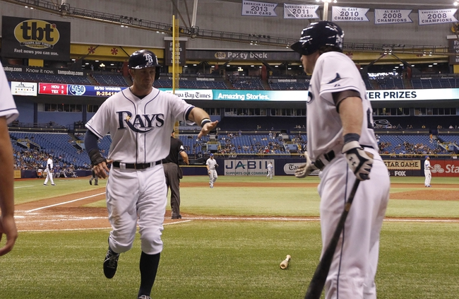 Jul 8, 2014; St. Petersburg, FL, USA; Tampa Bay Rays third baseman Evan Longoria (3) is congratulated by catcher Ryan Hanigan (24) after he scored during the ninth inning against the Kansas City Royals at Tropicana Field. Tampa Bay Rays defeated the Kansas City Royals 4-3. Mandatory Credit: Kim Klement-USA TODAY Sports