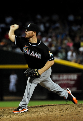 Jul 8, 2014; Phoenix, AZ, USA; Miami Marlins relief pitcher Sam Dyson (36) throws during the seventh inning against the Arizona Diamondbacks at Chase Field. Mandatory Credit: Matt Kartozian-USA TODAY Sports