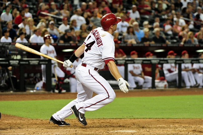 Jul 8, 2014; Phoenix, AZ, USA; Arizona Diamondbacks first baseman Paul Goldschmidt (44) hits a double during the seventh inning against the Miami Marlins at Chase Field. Mandatory Credit: Matt Kartozian-USA TODAY Sports