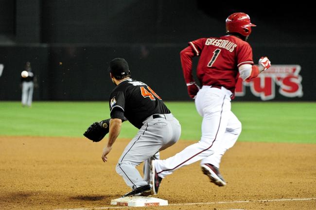 Jul 9, 2014; Phoenix, AZ, USA; Miami Marlins first baseman Garrett Jones (46) waits for the ball as Arizona Diamondbacks shortstop Didi Gregorius (1) is safe during the third inning at Chase Field. Mandatory Credit: Matt Kartozian-USA TODAY Sports