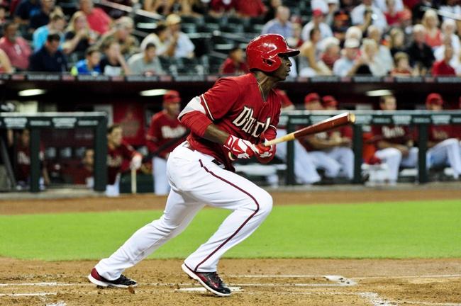 Jul 9, 2014; Phoenix, AZ, USA; Arizona Diamondbacks shortstop Didi Gregorius (1) hits a single during the third inning against the Miami Marlins at Chase Field. Mandatory Credit: Matt Kartozian-USA TODAY Sports