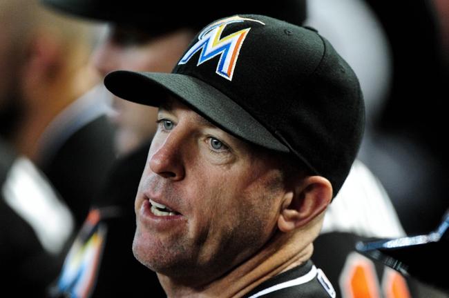 Jul 9, 2014; Phoenix, AZ, USA; Miami Marlins manager Mike Redmond (11) looks on during the seventh inning against the Arizona Diamondbacks at Chase Field. Mandatory Credit: Matt Kartozian-USA TODAY Sports