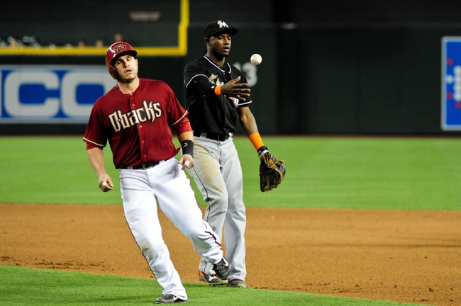 Jul 9, 2014; Phoenix, AZ, USA; Arizona Diamondbacks catcher Miguel Montero (26) after being caught in a run down by Miami Marlins shortstop Adeiny Hechavarria (3) during the seventh inning at Chase Field. Mandatory Credit: Matt Kartozian-USA TODAY Sports