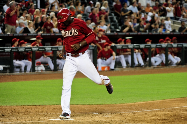 Jul 9, 2014; Phoenix, AZ, USA; Arizona Diamondbacks shortstop Didi Gregorius (1) scores on a single by shortstop Nick Ahmed (not pictured) during the eighth inning against the Miami Marlins at Chase Field. Mandatory Credit: Matt Kartozian-USA TODAY Sports