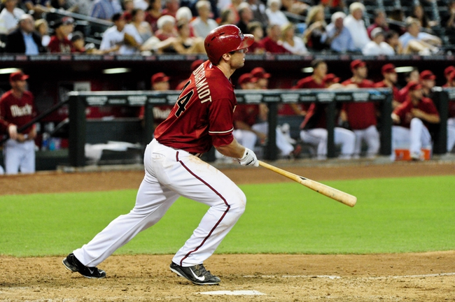 Jul 9, 2014; Phoenix, AZ, USA; Arizona Diamondbacks first baseman Paul Goldschmidt (44) hits a walk off double to beat the Miami Marlins 4-3 in the tenth inning at Chase Field. Mandatory Credit: Matt Kartozian-USA TODAY Sports