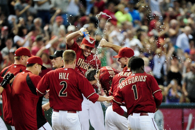 Jul 9, 2014; Phoenix, AZ, USA; Arizona Diamondbacks first baseman Paul Goldschmidt (44) is doused in celebration by teammates after hitting a walk off double in the tenth inning to beat the Miami Marlins 4-3 at Chase Field. Mandatory Credit: Matt Kartozian-USA TODAY Sports
