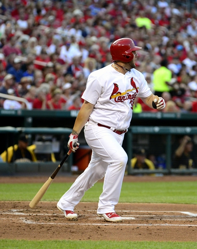 Jul 9, 2014; St. Louis, MO, USA; St. Louis Cardinals first baseman Matt Adams (32) hits a two run double off of Pittsburgh Pirates starting pitcher Brandon Cumpton (not pictured) during the first inning at Busch Stadium. Mandatory Credit: Jeff Curry-USA TODAY Sports