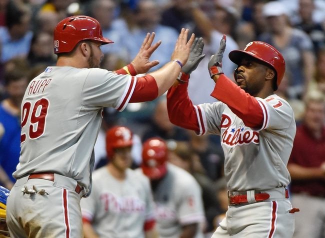 Jul 9, 2014; Milwaukee, WI, USA;  Philadelphia Phillies shortstop Jimmy Rollins (11) is greeted by catcher Cameron Rupp (29) after hitting a 2-run home run in the sixth inning against the Milwaukee Brewers at Miller Park. Mandatory Credit: Benny Sieu-USA TODAY Sports