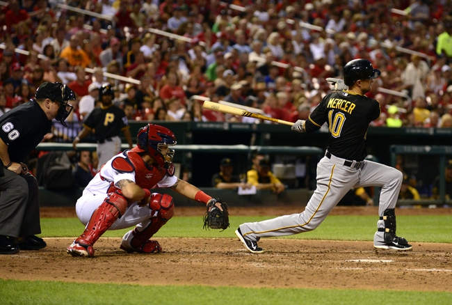 Jul 9, 2014; St. Louis, MO, USA; Pittsburgh Pirates shortstop Jordy Mercer (10) hits a one run single off of St. Louis Cardinals starting pitcher Lance Lynn (not pictured) during the fourth inning at Busch Stadium. Mandatory Credit: Jeff Curry-USA TODAY Sports